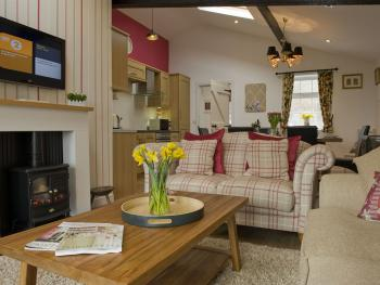 Relax by the fire and enjoy the glorious views from the Garden Cottage