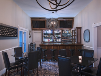 Alexander's Distillery features a full bar on 1st floor, directly overlooking Salado Creek. Guests enjoy the complete restaurant menu as well as cocktails, wine, and a variety of beers on tap.