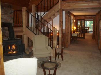 Enjoy the gas stove and the post & beam architecture in lobby area