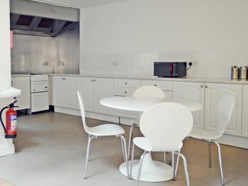 There is a large kitchen for guest use attached to the dining area and lounge