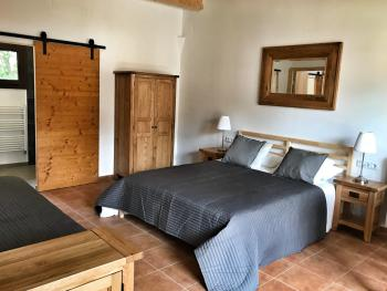 Garden suite with double bed and individual bed. Private walk in shower room.