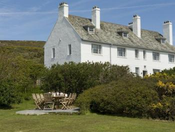 The Coastal House (left) and Coastal Cottage (right) both have extensive gardens and beautiful sea / moutain views