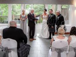 Wedding ceremony in our riverside conservatory
