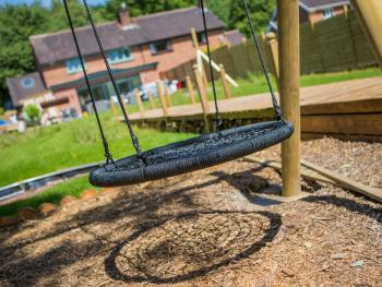 Garden with children's playground including swing