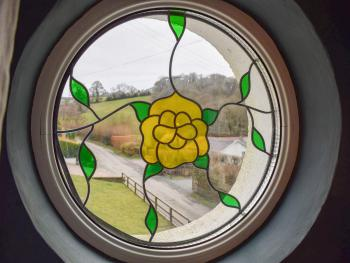 View through the lovely round window in the main bedroom.