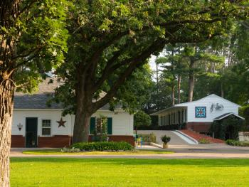 The property is comprised of three distinct buildings. The carriage house (left) suites 1-3, and the historic motor lodge (right) rooms 4-9.  The house (not pictured) is lobby and breakfast room.