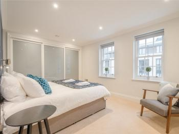 James Street Townhouse - Master bedroom with super king size bed, floor to ceiling wardrobes and a modern ensuite bathroom.