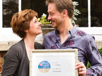 Property owners, Simon & Louise with an award