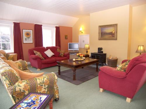 Comfortably furnished sitting room with log burner, flat screen, free-to-air TV and DVD player, and WIFI internet access.