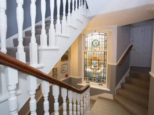 Stairwell with Stained Glass Window