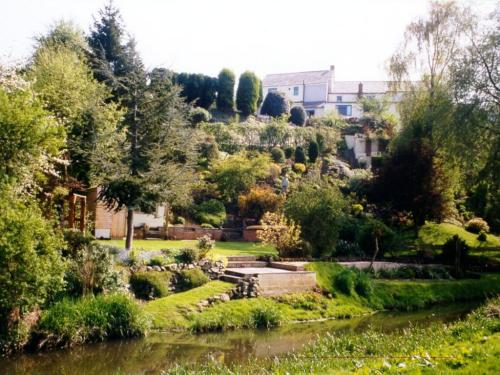 Part of the unique hillside garden from the River Perry up to Brownhill House