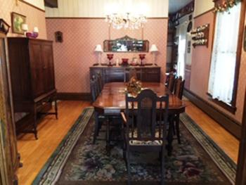 Guests eat breakfast on the home's original dining room furniture.