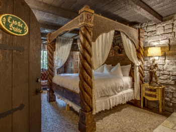 Wood-carved Four Poster King Bed fit for royal sleep in the Castle Suite