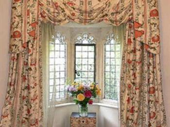 The Gothic Room is a luxury double room with a romantic stone mullioned bay window.