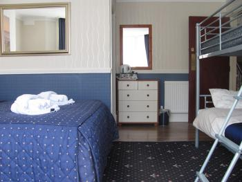 Room 6.Is another large spacious family/double room with ensuite shower,tea/coffee making facilities,colour tv,complimentary
