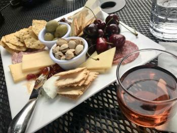"Signature ""Twisp Plate"" and wine"