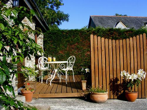 A pretty private area outside Lobhill Cottage to relax and enjoy the sun.