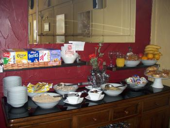 Breakfast bar, help yourself to, cereal,fresh fruit, yoghurts,pastries, & croisents