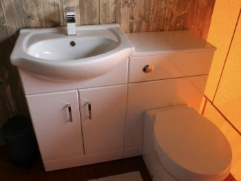 Flushing toilet with hot&cold water and storage in bathroom - inside tent!
