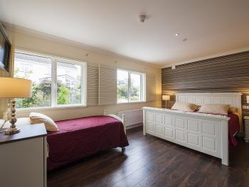 Family room- King and single bed- Garden view