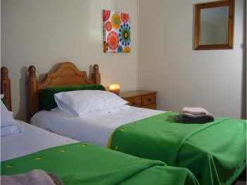 Dairy Up - self catering or b & b cottage, Twin room and also double room with single bed.  One bathroom with bath tub. Upstairs