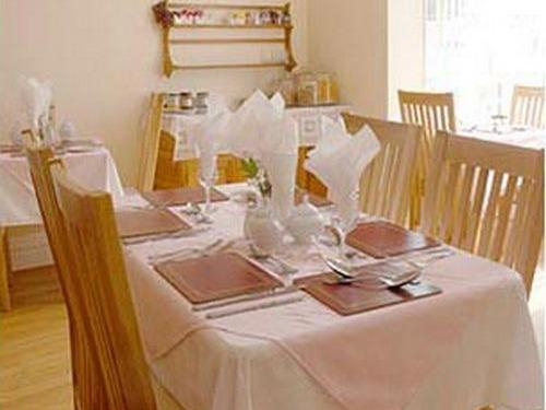light and spacious dining room, serving home cooked meals.
