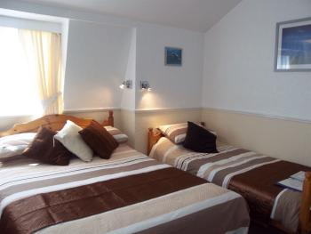 Refurbished family room to sleep 2 adults & 1 child  TV drinks facilities. Ensuite with shower, towels/selection of toiletries