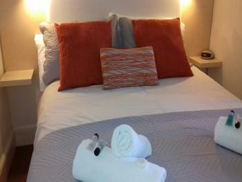 Fluffy soft white towels and complementary toiletries