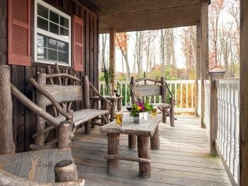 Dogwood chalets front porch with beautiful sassafras furniture.