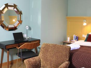 Spacious seating area and work desk in 'The Willow' guest room