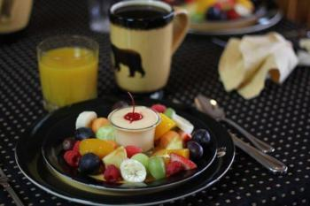 Morning fruit plate, coffee and orange juice