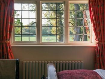 Bedroom 1 enjoys open views down over garden, fields and woodland.