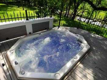 Lodging guests enjoy the massaging jets of our 900 gallon hot tub.  The beautiful wrought iron surround allows an unobscured view of our creekside grounds.  Arguably the best place in the Village to w