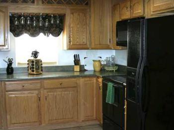 Fully equipped kitchen with electric stove, microwave, full size refrigerator/freezer and dishwasher.
