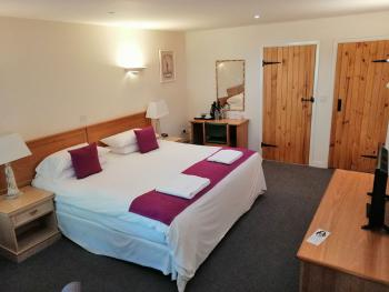Double room with super king bed and ensuite bathroom with bath and shower