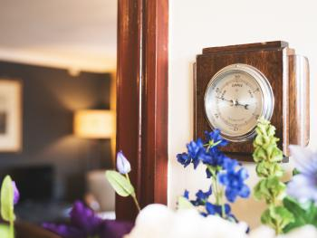 Weather Barometer & flower arrangement