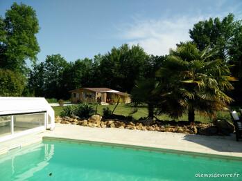 Vue sur le cottage de la piscine