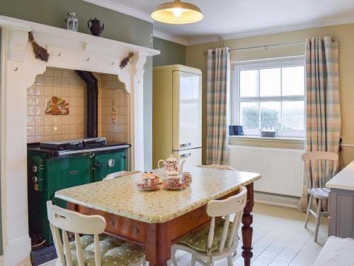 The dining area leads out to the conservatory where you can relax all year round.  There is also an American style fridge freezer!