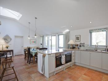 The large kitchen and dining room - with doors onto the terrace