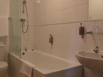 Room 3- Bathroom with bath and shower