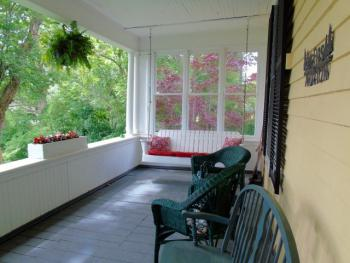 A view of half of our veranda with the porch swing
