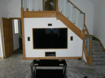 The TV with surround sound from the sofa