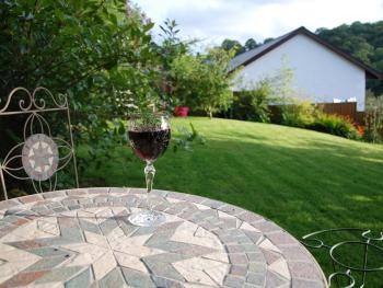 Enjoy a relaxing glass of wine in the garden.