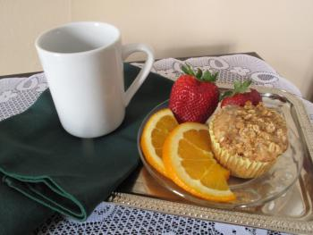 Our fresh Pear Oatmeal muffin served with coffee at 8 am