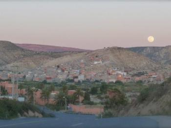 Full moon rising over Ida-Outanane mountain range