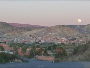 Full moon rising over Ida-Outanane mountain range