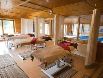 Treetops Spa Therapy Room with electric massage beds for guest's comfort