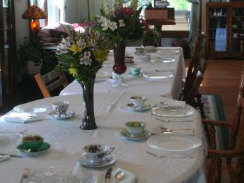 Table set for an afternoon tea party.