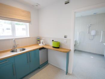 The easy access suite incorporates a small kitchen with access to large wet room