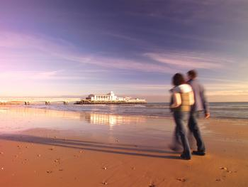 Walking on Bournemouth Beach - courtesy of Bournemouth Tourism